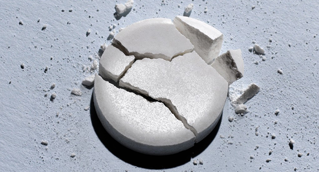 image of cracked methaqualone tablet